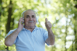 Happy senior man listening to music